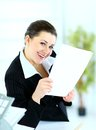 Business woman holding reports and looking Royalty Free Stock Photography