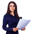 Business woman holding reports and looking at camera isolated over white young Stock Photo