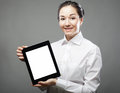 Business woman holding a tablet computer isolated over gray background Stock Photos