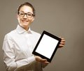 Business woman holding a tablet computer isolated over gray background Royalty Free Stock Images