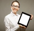 Business woman holding a tablet computer isolated over gray background Royalty Free Stock Photography