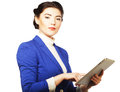 Business woman holding a tablet computer isolated over white background Stock Photography