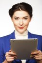 Business woman holding a tablet computer isolated over white background Royalty Free Stock Photos