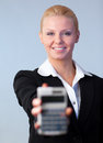 Business woman holding up a calculator Royalty Free Stock Photo
