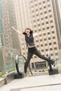 Business woman jump excited outside modern city Stock Photo