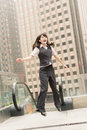 Business woman jump excited outside modern city Royalty Free Stock Image
