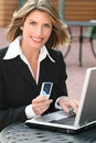Business Woman with Laptop and Cell Phone Outdoors Stock Photo