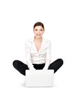 Business woman laptop sits floor isolated white Royalty Free Stock Photography