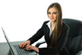 Business woman with laptop working on her at her desk Stock Photography