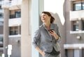 Business woman laughing with mobile phone Royalty Free Stock Photo
