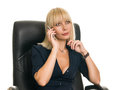 Business woman in a leather chair talking on the phone Royalty Free Stock Image