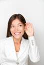 Business woman listening with hand to ear concept businesswoman listen to something smiling happy in suit beautiful multicultural Royalty Free Stock Images