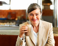 Business woman on lunch break smiling kindly Stock Photography