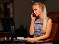 Business woman make career calling on phone in the office late night Royalty Free Stock Photography