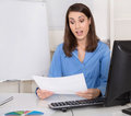 Business woman make controlling and is shocked about costs expenses Stock Photo