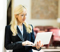 Business woman making online order on her laptop technology internet hotel concept closeup portrait happy smiling businesswoman Stock Images
