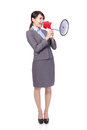 Business woman with megaphone yelling Royalty Free Stock Photo