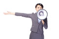 Business woman with megaphone yelling and showing Stock Photo