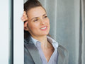 Business woman near window looking into distance dreamy Stock Images