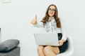 Business woman with notebook in the office. Okey gesture. Royalty Free Stock Photo