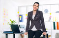 Business woman in the office posing Royalty Free Stock Photo