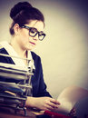Business woman in office writing something down Royalty Free Stock Photo