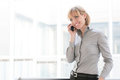 Business woman at phone Stock Photography