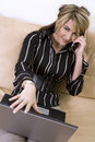 Business woman on the phone and laptop Stock Image