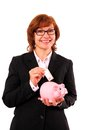 Business woman with piggy bank and fifty euro in hand Royalty Free Stock Photo