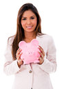Business woman with a piggybank isolated over white background Royalty Free Stock Images