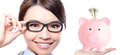 Business woman and pink piggy bank touch eye glasses holding with smiling happy beautiful young asian Royalty Free Stock Photos