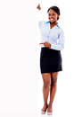 Business woman pointing at a banner Royalty Free Stock Photo