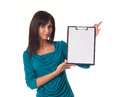 Business woman pointing in blank clipboard beautiful isolated over a white background Stock Image