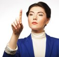 Business woman pointing her finger virtual button young on imaginery Stock Image