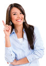 Business woman pointing idea smiling isolated over white Stock Photography