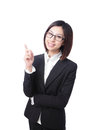 Business woman pointing at something in the air Royalty Free Stock Photo