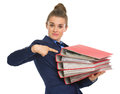 Business woman pointing on stack of folders Stock Images