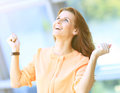 Business woman portrait smiling and rejoicing his success raising  arms up Royalty Free Stock Photo