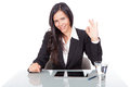 Business woman with positive gesture young sitting on the desk Royalty Free Stock Images