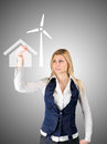 Business woman presents the future of the house with self-contained power consumption Royalty Free Stock Photo