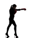 Business woman punching boxing gloves silhouette Royalty Free Stock Photo