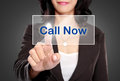 Business woman push to call now button on virtual screen portrait of Stock Photo