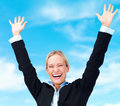 Business woman raising her arms in joy to sky Royalty Free Stock Photo