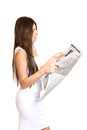 Business woman reading a newspaper on a white background