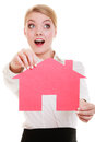 Business woman real estate agent holding red paper house surprised shocked face expression property and accomodation or loan Royalty Free Stock Images