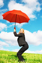 Business woman with red umbrella Stock Photos