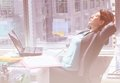 Business woman relaxing with hands behind her head and sitting on an office chair concept vintage style Royalty Free Stock Photo