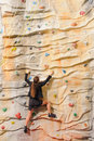 Business woman on rock wall Royalty Free Stock Images