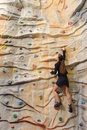 Business woman on rock wall active young in sport center Royalty Free Stock Photography