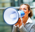 Business woman screaming into a megaphone Royalty Free Stock Photo